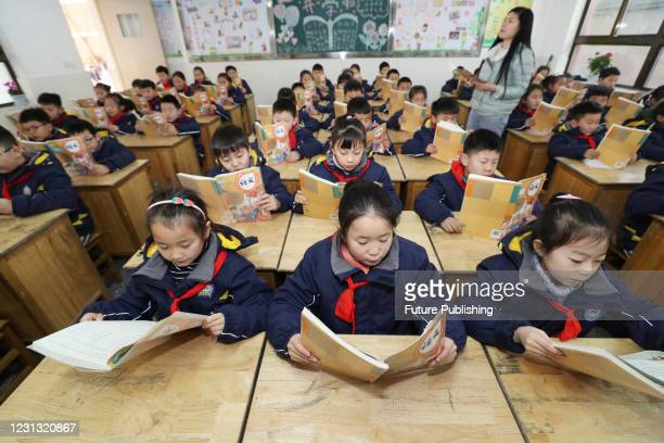 Pupils read a new text in a classroom in Lianyungang, east China's Jiangsu province, Feb 22, 2021. - PHOTOGRAPH BY Costfoto / Barcroft Studios /...
