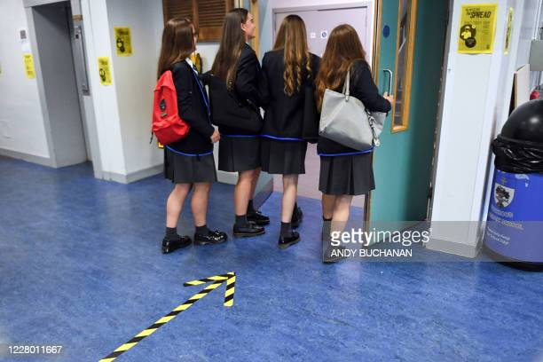 Pupils returns to Holyrood Secondary School in Glasgow for the first time following the easing of coronavirus lockdown measures on August 12, 2020. -...