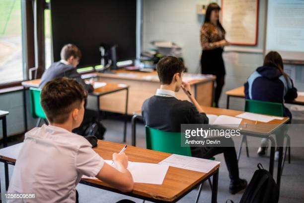 Pupils sit apart during a socially distanced language lesson at Longdendale High School on July 16, 2020 in Hyde, England. The Government plan to...