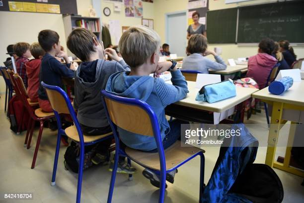 Pupils sit in a classroom at a primary school on the first day of the new school year on September 4 in Quimper western France / AFP PHOTO / FRED...