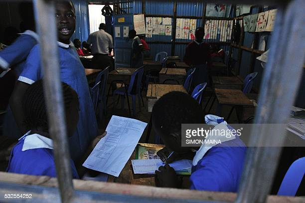Pupils study in a classroom of Kibera School for Girls at Nairobi on May 19 2016 Kibera School for Girls offers free tuition uniforms books and meals...
