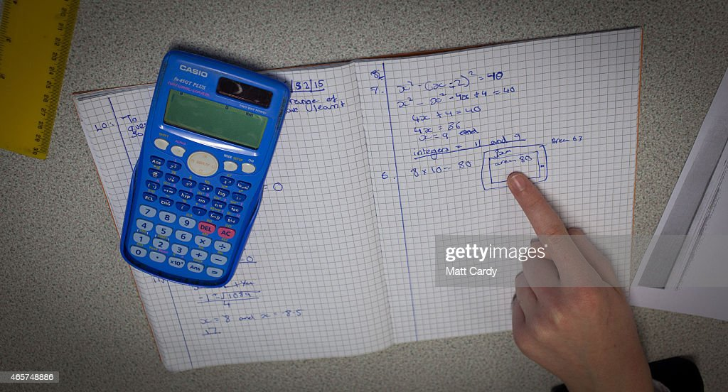 Pupils take part in a maths lesson at the Ridings Federation Winterbourne International Academy in Winterbourne near Bristol on February 26, 2015 in South Gloucestershire, England. Education, along with National Health Service and the economy are likely to be key election issues in the forthcoming general election in May.