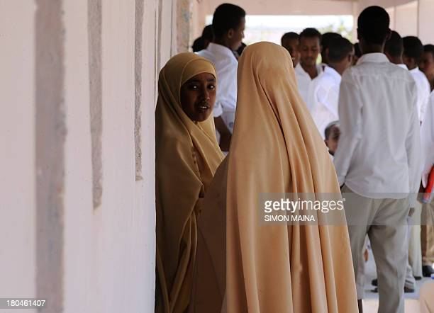 Pupils talk during breaktime on September 10 2013 at the Gambool high school in the Garowe region Somaliland The school is a project funded by the...
