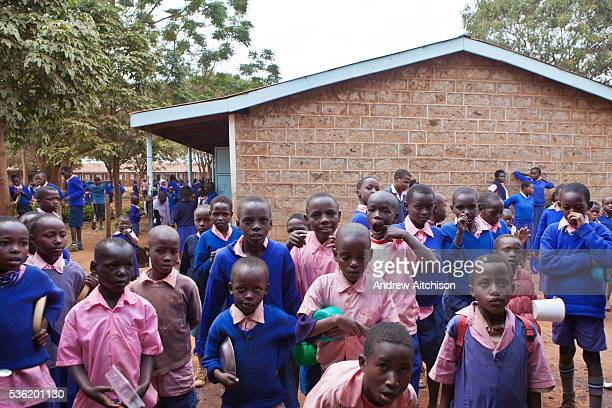 Pupils wait for their lunch to be served at Graissa Road Primary School in Thika, Kenya. The kitchen staff wages are paid by AFCIC . The majority of...