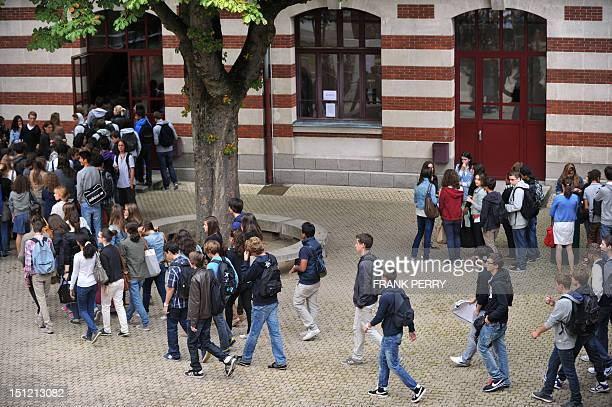 Pupils wait in line in a courtyard on September 4 2012 at the Guist'hau highschool in Nantes western France before the start of the new school year...
