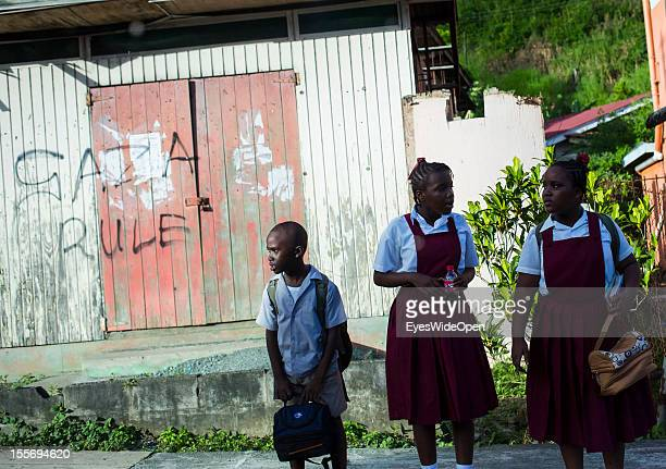 Pupils waiting for a bus on October 21 2012 in Scarborough Trinidad And Tobago