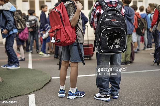 Pupils walk in an elementary school on September 2 2014 in Paris at the start of the new school year AFP PHOTO / FRED DUFOUR
