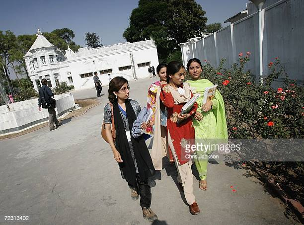 Pupils walk through Fatima Jinnah college on the third day of the Royal Tour of Pakistan on October 31 2006 in Islamabad Pakistan Prince Charles and...