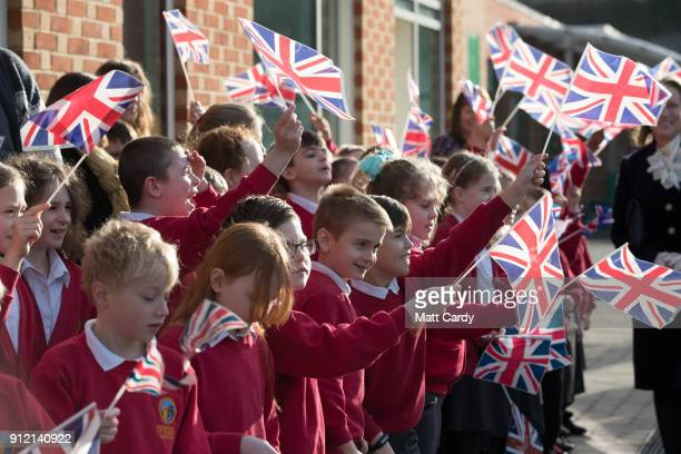 Pupils wave flags as they wait for Camilla Duchess of Cornwall to visit Marlborough St Mary's Church of England Primary School in Marlborough on...