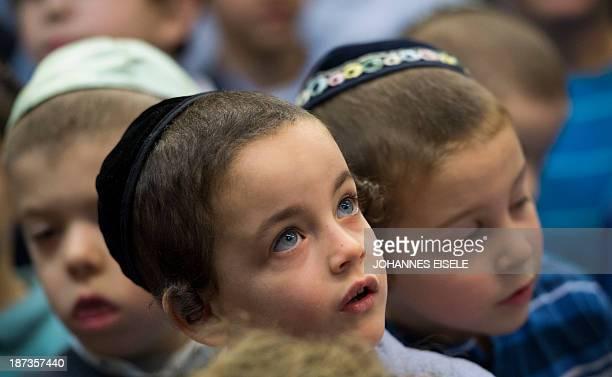 Pupils wear the kippah while awaiting Ashkenazi Chief Rabbi of Israel at the Or Avner traditional Jewish school in Berlin on November 8 2013 David...