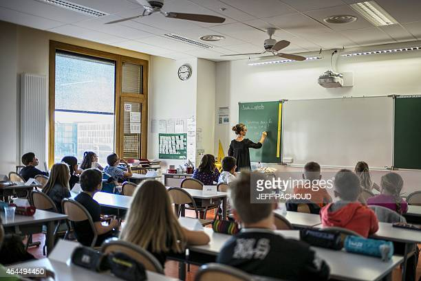 Pupils work in their classroom of a elementary school on September 2 2014 in Lyon on the first day of the French new school year AFP PHOTO / JEFF...