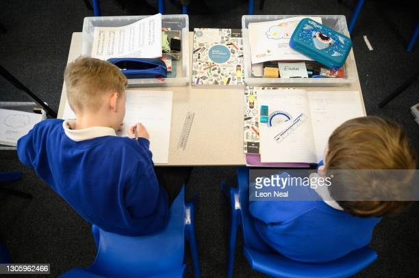 Pupils work on a maths problem as classes return to Gamlingay Village Primary on March 08, 2021 near Bedford, United Kingdom. The school, which is...