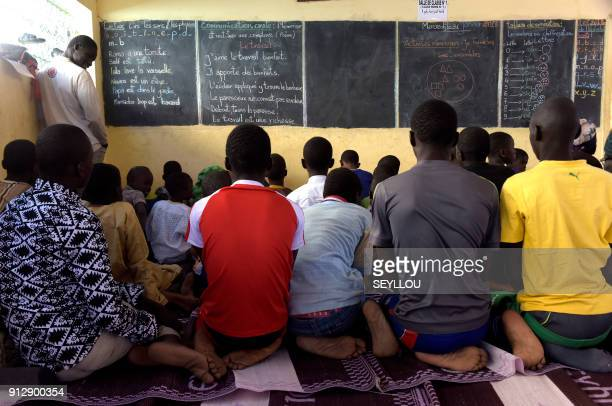 Pupils write their lesson as they listen their teacher during class at a pilot school of the Global Partnership for Education, in Tivaouane, near...