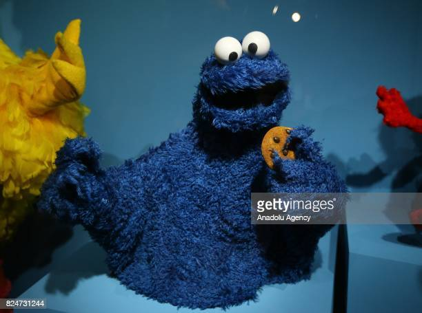 Puppet 'Cookie Monster' character of the famous TV serie Sesame Street is displayed during an exhibition in memory of American puppeteer and movie...