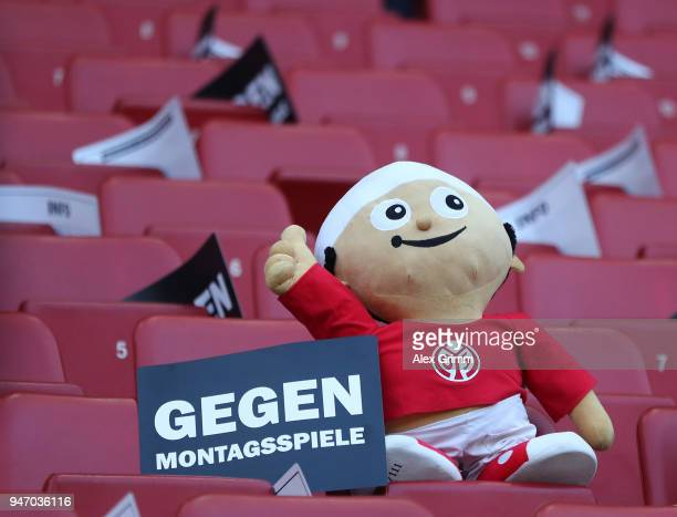A puppet fan is ssen on a seat next to a plackard to be used as part of a Choreografie prior to the Bundesliga match between 1 FSV Mainz 05 and...