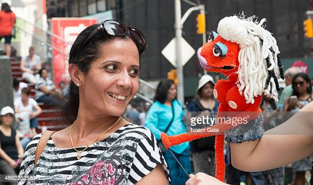 Puppet Jolene of Broadway's 'Hand to God' visit Duffy Square in Times Square on September 2 2015 in New York City