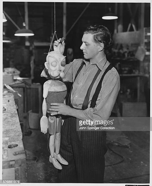 Puppet maker Russell Patterson holds one of the puppets used in Jack Benny's 1937 musical Artists and Models
