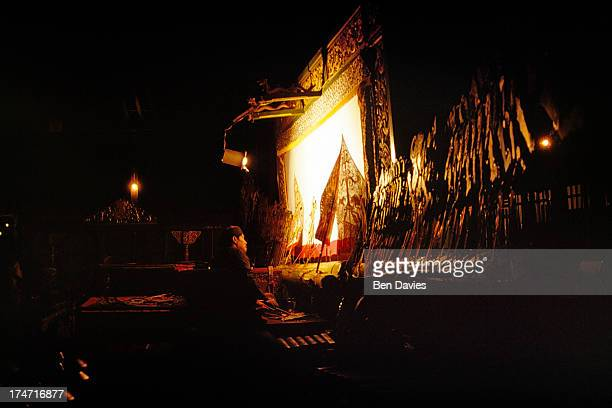 A puppet master prepares a display of 'wayang kulit' or shadow puppets in Yogyakarta the cultural centre of Java Puppet plays have their origins in...