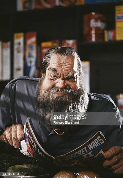 A puppet of American actor and director Orson Welles reading comic book 'Secret Wars II' in the British satirical puppet show 'Spitting Image' circa...