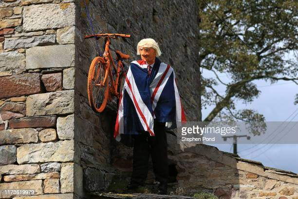 Puppet of Boris Johnson of Great Britain British Prime Minister / Bike / Flag / Joke / during the 16th Tour of Britain 2019 Stage 4 a 1732km stage...
