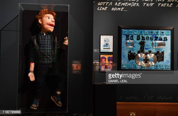 A puppet of British musician Ed Sheeran used the music videos for the songs Sing and Happier designed by Steve Troop and BJ Guyer of Puppet Design...