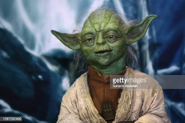 Puppet of iconic character, Yoda sits at a display showcase at The Star Wars Identities exhibition at The ArtScience Museum on January 19, 2021 in...