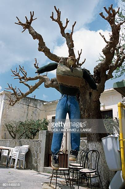 Puppet representing Judas hanging from a tree during Easter celebrations Perivolakia Crete Greece