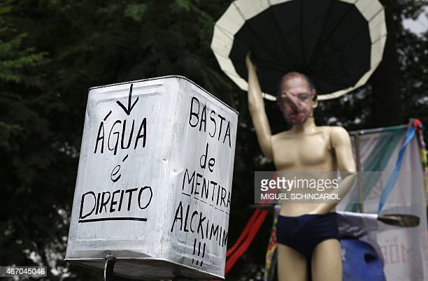 A puppet representing the Governor of Sao Paulo state Geraldo Alckmin is seen during a protest against the hydro crisis in the state at Paulista...