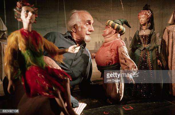 Puppeteer Hans Koenig Controlling Marionettes