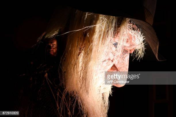 A puppeteer looks out from the head of a giant animatronic puppet of an old man in a boat at the start of the Land of Green Ginger Unleashed...
