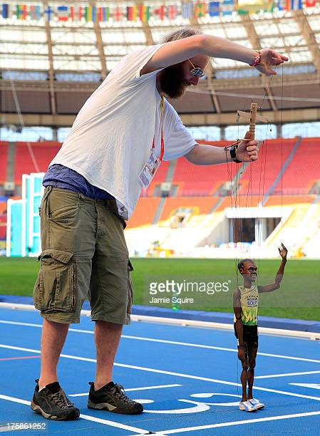 A puppeteer stands on the finish line with a Usain Bolt of Jamaica puppet ahead of the 14th IAAF World Athletics Championships Moscow 2013 at the...