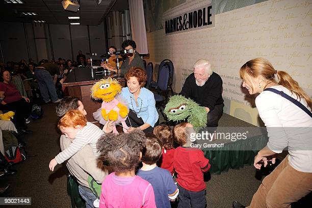 Puppeteers Fran Brill with 'Sesame Street' puppet Zoe and Caroll Spinney with Oscar the Grouch entertain children at Sesame Street A Celebration of...