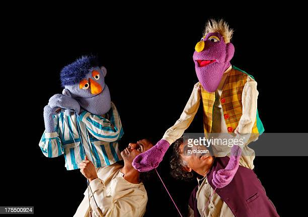 puppeteers - puppet stock pictures, royalty-free photos & images