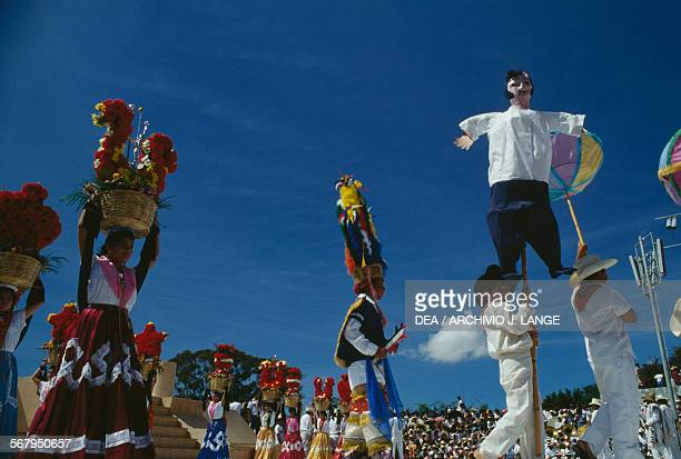 Puppets and dancers during the celebrations at the Guelaguetza festival Oaxaca Mexico