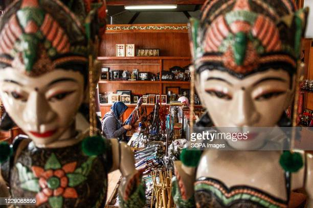 Puppets are seen while in the background a woman makes a puppet costume in Cupumanik Gallery Cupumanik Puppets Gallery which was founded in 1970 has...