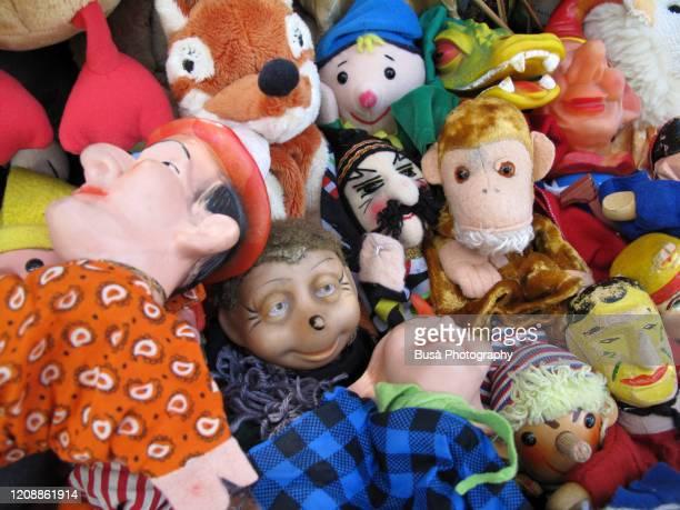 puppets for sale in a flea market in berlin, germany - lugar histórico imagens e fotografias de stock