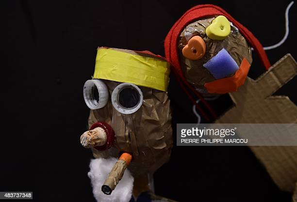Puppets made by children and representing characters of Spanish writer Miguel de Cervantes' work Don Quijote de la Mancha are shown at the exhibition...