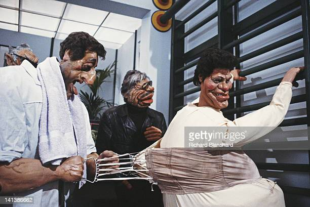 Puppets of actors Sylvester Stallone and Charles Bronson help a puppet William Shatner with his corset in the British satirical puppet show 'Spitting...