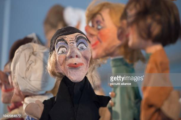 Puppets stand in the exhibition 'First best puppetry week curious things from Kasper and co' at the museum for Saxonian volk arts inDresden Germany...