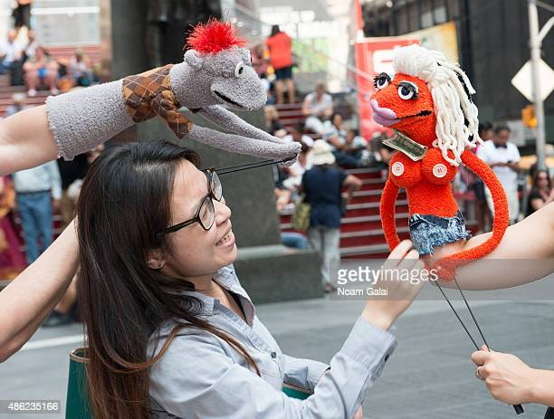 Puppets Tyrone McHansely and Jolene of Broadway's 'Hand to God' visit Duffy Square in Times Square on September 2 2015 in New York City