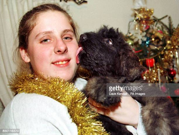 Puppy love for Shilo Ediger 21 yrs who has flown over from Oklahoma USA to choose a puppy from Merseyside specialist dog breeder Mike Oliver She is...