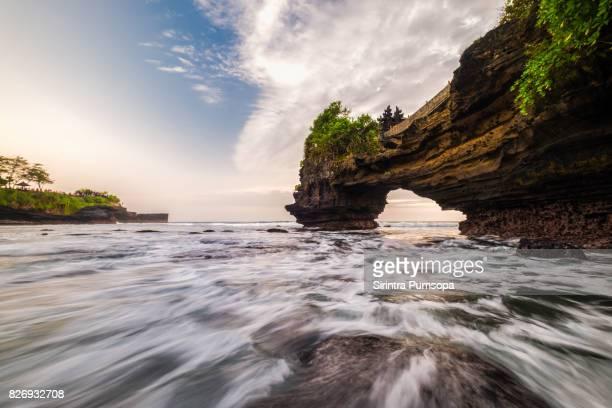 Pura Batu Bolong during sunset in Bali, Indonesia.