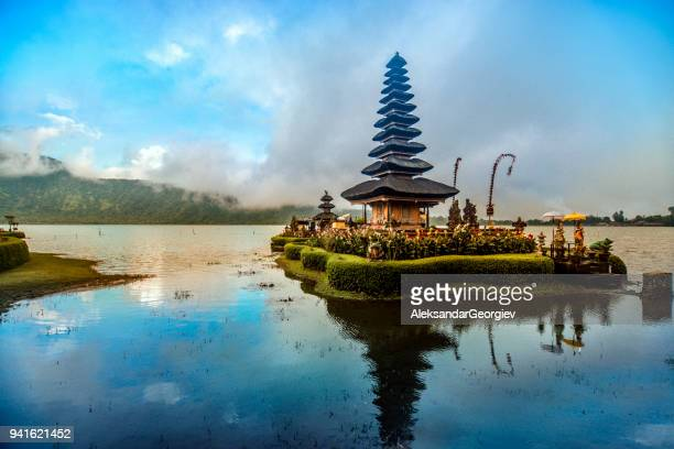 pura ulun danu beratan the floating temple in bali at sunset - bali stock pictures, royalty-free photos & images