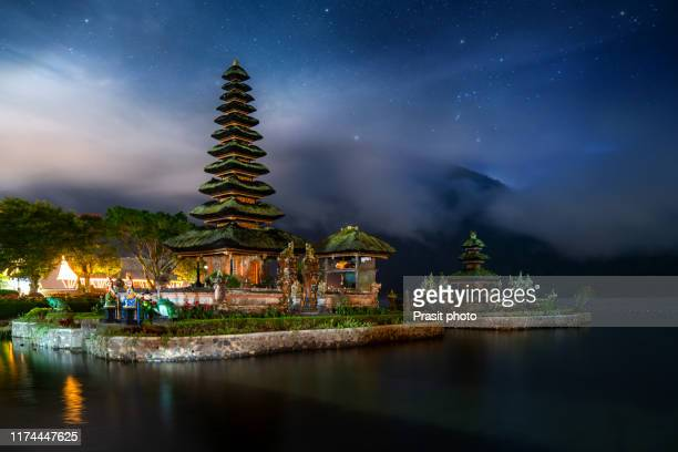 pura ulun danu bratan, hindu temple on bratan lake landscape, one of famous tourist attraction with million star on sky in bali, indonesia - lake bratan area stock pictures, royalty-free photos & images