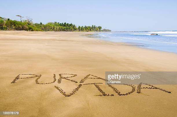 Pura Vida written on Costa Rican beach