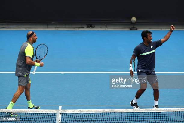 Purav Raja of India and Leander Paes of India celebrates winning a point in their second round men's doubles match against Jamie Murray of Great...