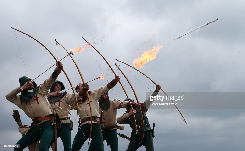 Purbrook Bowmen fire a volley of flaming arrows from Southsea Castle as part of a day of events to mark the opening of the Mary Rose Museum on May 30, 2013 in Portsmouth, England.The Mary Rose was warship of the Tudor navy of King Henry VIII. She sank in the Solent on 19 July 1545 during an invasion by the French fleet. The wreck of the Mary Rose was rediscovered in 1971 and salvaged in 1982. The Mary Rose Museum in Portsmouth's Historic Dockyard is the new home to warship, and some of the 19,000 artifacts that sank with her. The museum opens 30 years after the hull of Mary Rose was raised from the sea.