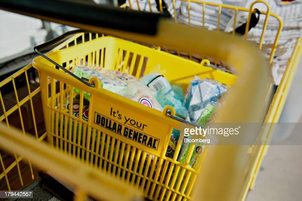 Purchased items sit in a shopping cart outside a Dollar General Corp store in Princeton Illinois US on Tuesday Sept 3 2013 Dollar General Corp is...