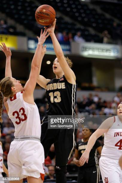 Purdue Boilermaker forward Bridget Perry with the jump shot from the lane over Indiana Hoosiers forward Amanda  Cahill during the game game between...