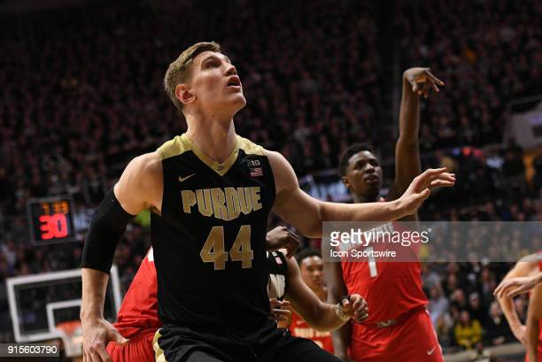 Purdue Boilermakers center Isaac Haas looks to rebound as Ohio State Buckeyes forward Jae'Sean Tate shoots a free throw during the Big Ten Conference...